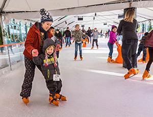 Mom and child skating at Winter Village.