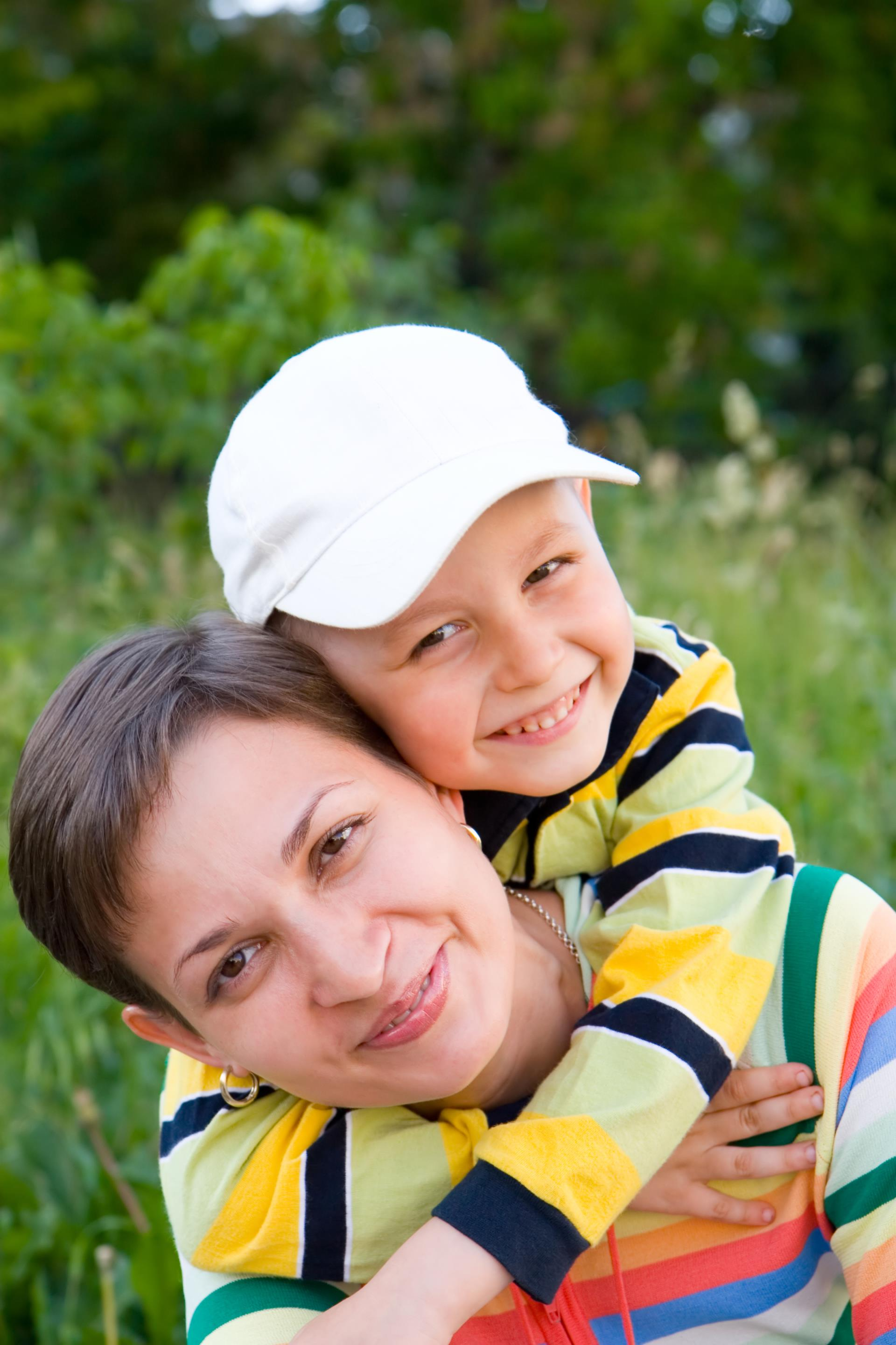 Closeup image of a Mom & Son in a field