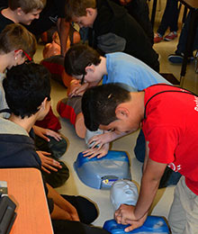 8th grade students at RA Brown Middle School practicing chest compressions reduced