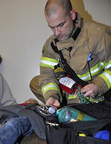 HFD Paramedic treating patient